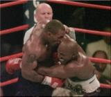 Mike Tyson biting Evander Holyfield's ear